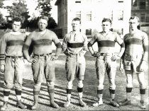 Image of Merritt Adamson Jr (second from left) and rugby teammates. undated