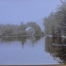 Image of Postcard - Black and White postcard of Prentiss Pond by Charles Parker, Dorset, VT. Note commercial buildings on the north side. Sent by H.W.J. to Mrs. James Taylor, Norwich, VT.