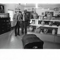 Image of Print, Photographic - Three large Black & White photos of Fred Whittemore and Arthur Gilbert showing display of Fenton Pottery at the former Dorset Village Firehouse.