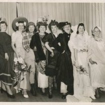 Image of Altar and Rosary Society Mock Fashion Show in standing pose. - Print, Photographic