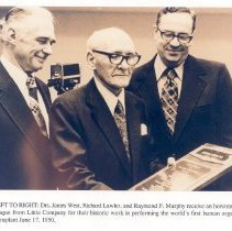Image of James West, M.D., Richard Lawley, M.D., and Raymond P. Murphy, M.D. with honorary plaque. - Print, Photographic
