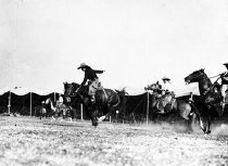Image of CWi 152 - Cowboys riding in arena
