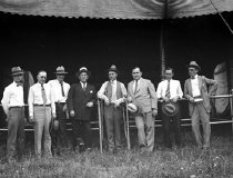 Image of CWi 165 - Group of executives in front of Marquee.