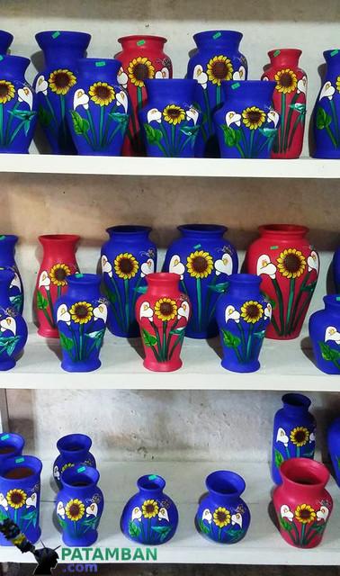 estatante con floreros de patamban