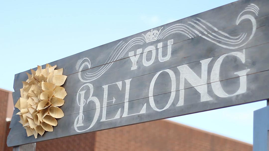 you belong banner at event