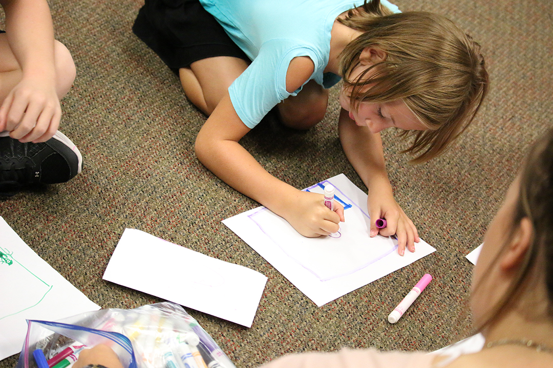 child coloring on floor
