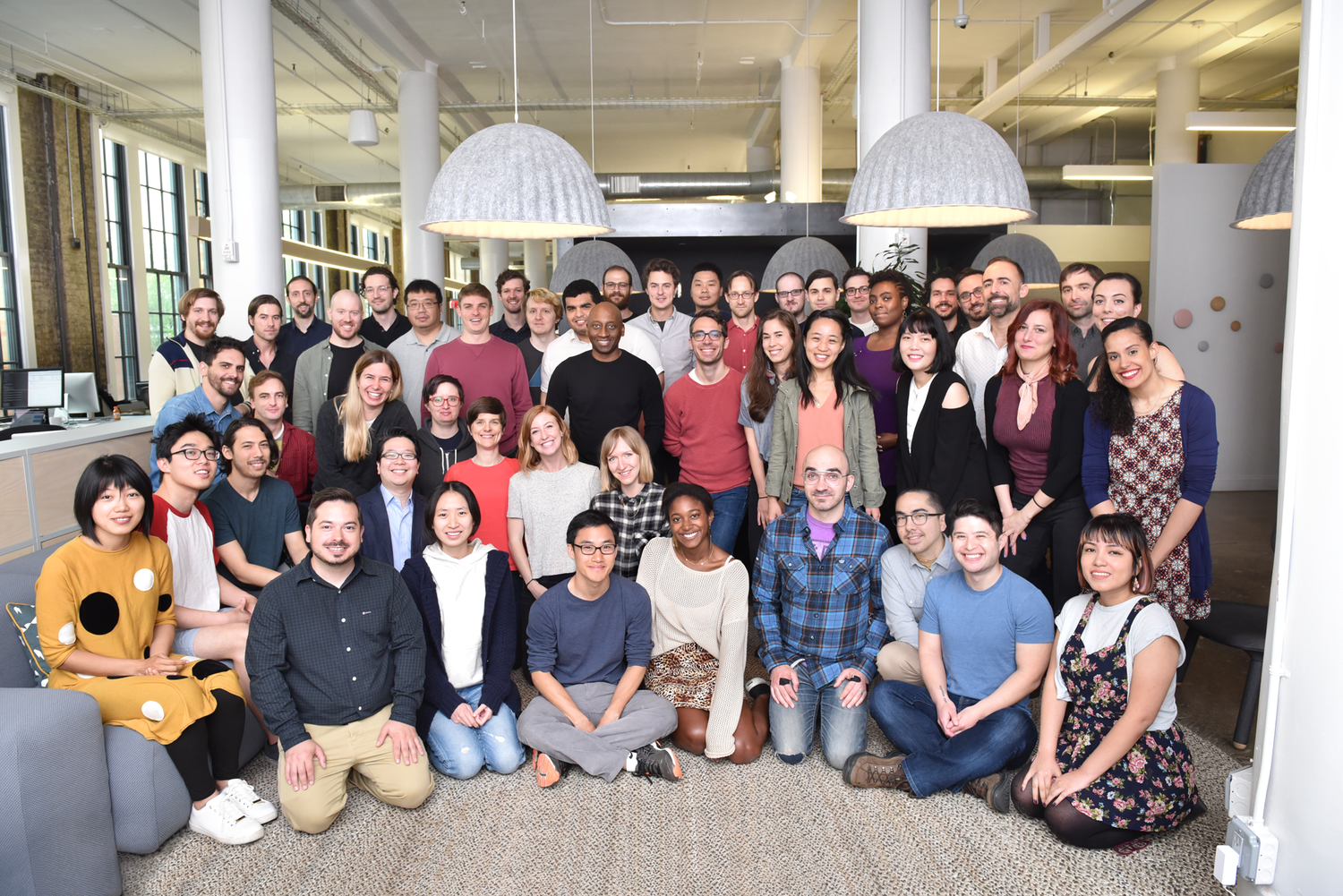 Group photo of employees in the Dots office