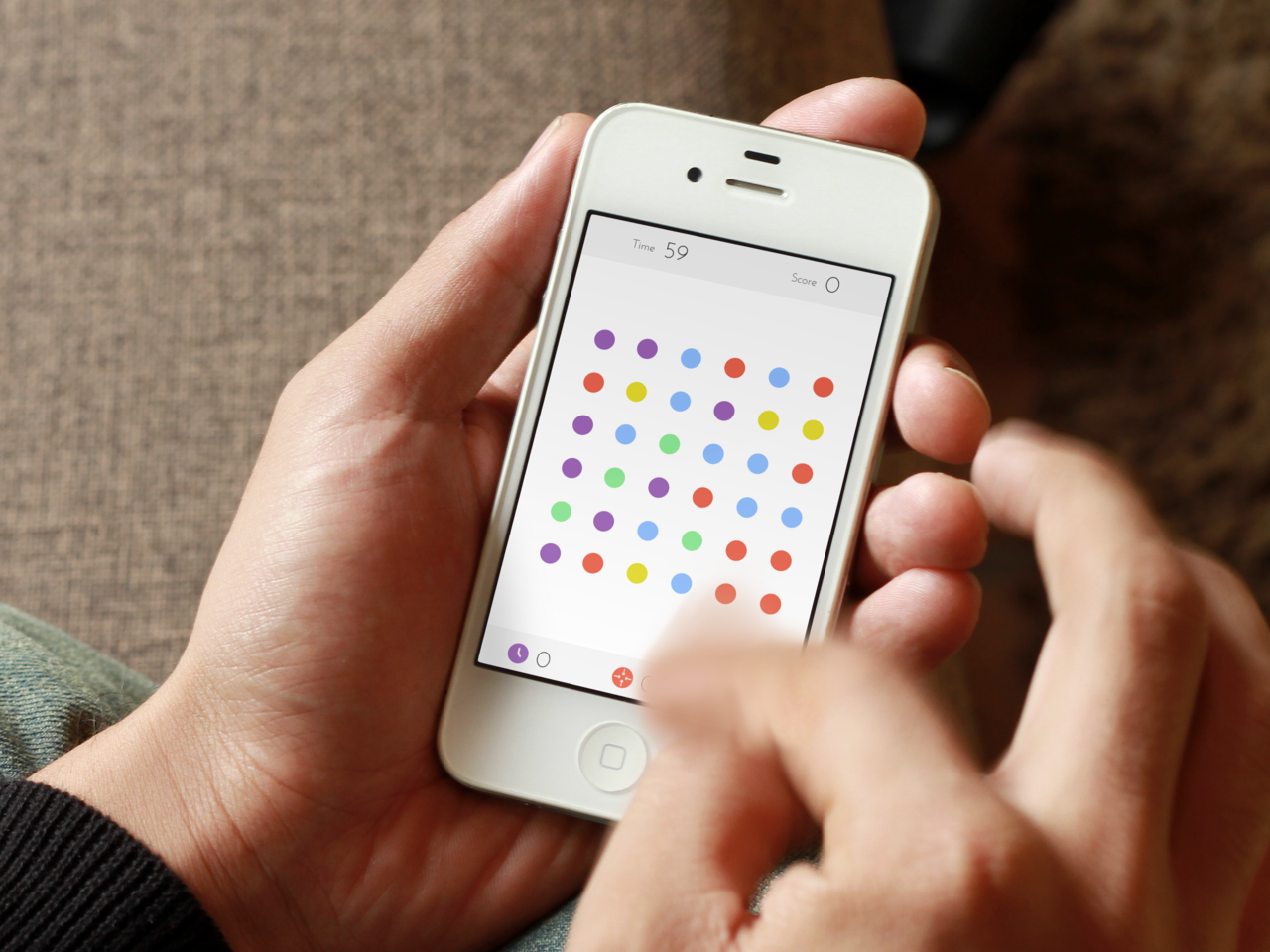 Person playing Dots game on mobile device