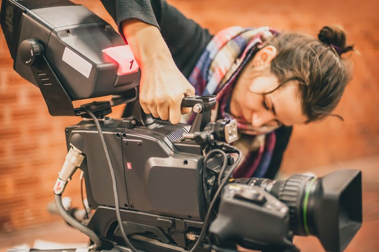 The Secrets of Making Money as a Documentary Filmmaker — Camera Person Shooting Scene