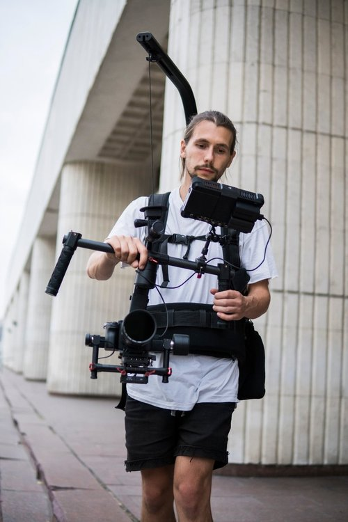 Cameraman Filming with an Easyrig