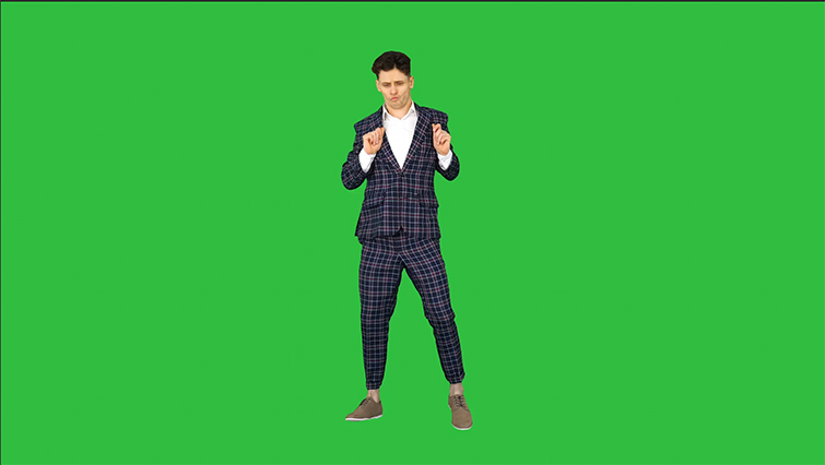 Man in Plaid Suit in Foreground of Green Screen