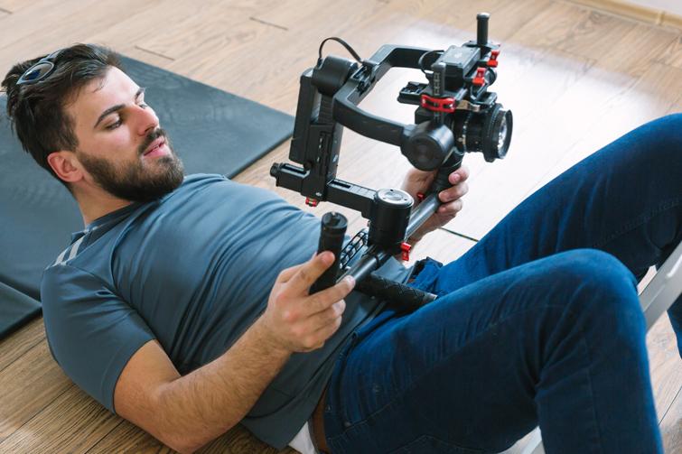 videographer using gimbal