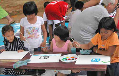 The children enjoying painting, arts and other craft activities