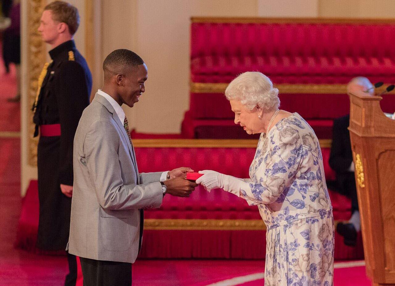 Trevis Belle Receiving Queen's Young Leader Award