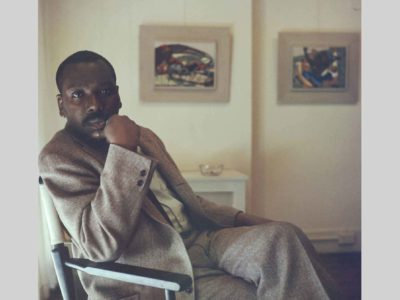 Artist Jacob Lawrence with Panel 26 and Panel 27 from Struggle Series