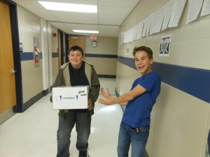 """JR and Collin deliver the package titled """"Live Fish."""""""