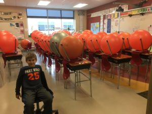 cute kid in classroom full of exercise balls