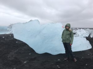 teacher in front of an iceberg