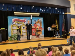 Superhero Math Assembly.  Students participating on stage.