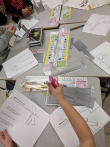 Constructing paper helicopters.