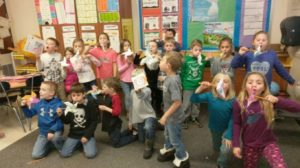 Students blowing on the pinwheels they made in class.  Demonstration of wind energy.
