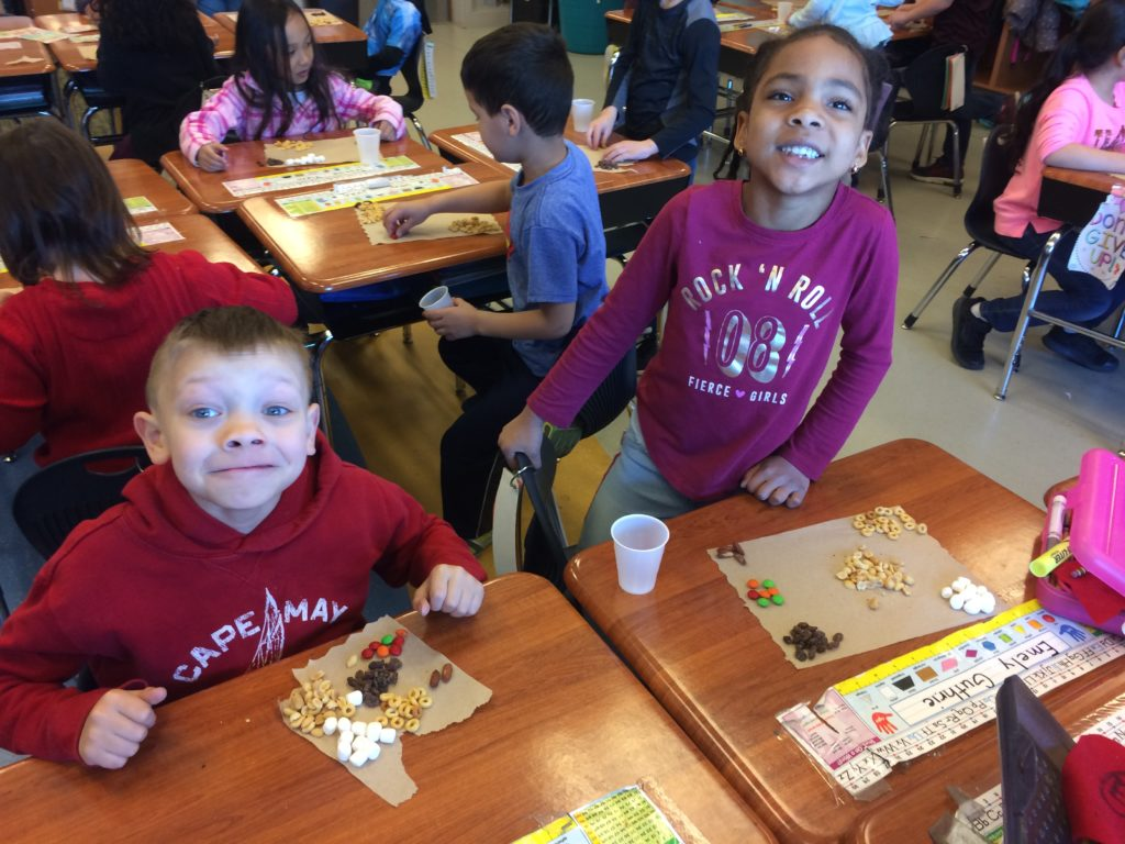 students learning about mixtures with trail mix