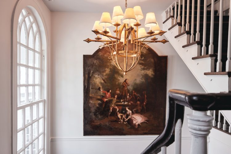colonial painting next to stairs