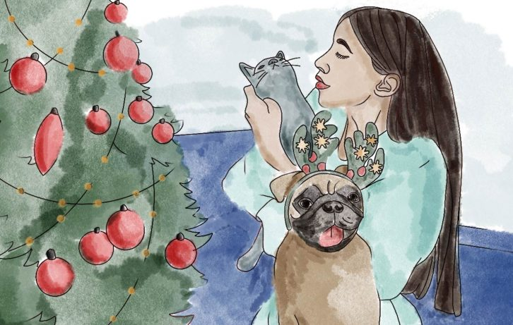 A watercolor painting by Chewy Studios of a woman with her cat and dog by a holiday tree.