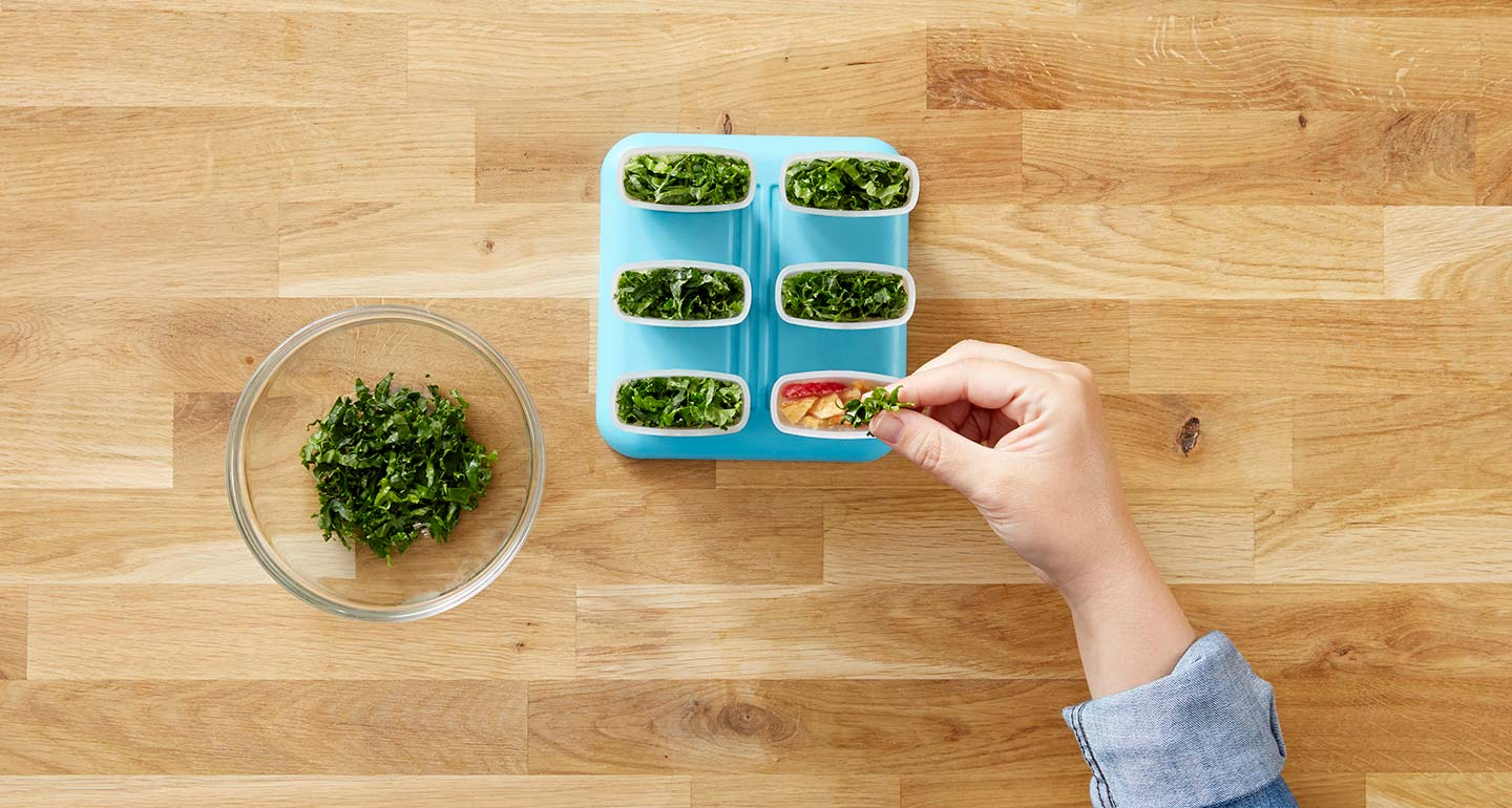 Cut the kale leaf into ribbons and top each mold with the garnish.