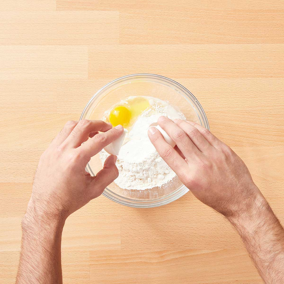 Add flour, peanut butter, egg and water to a large mixing bowl.