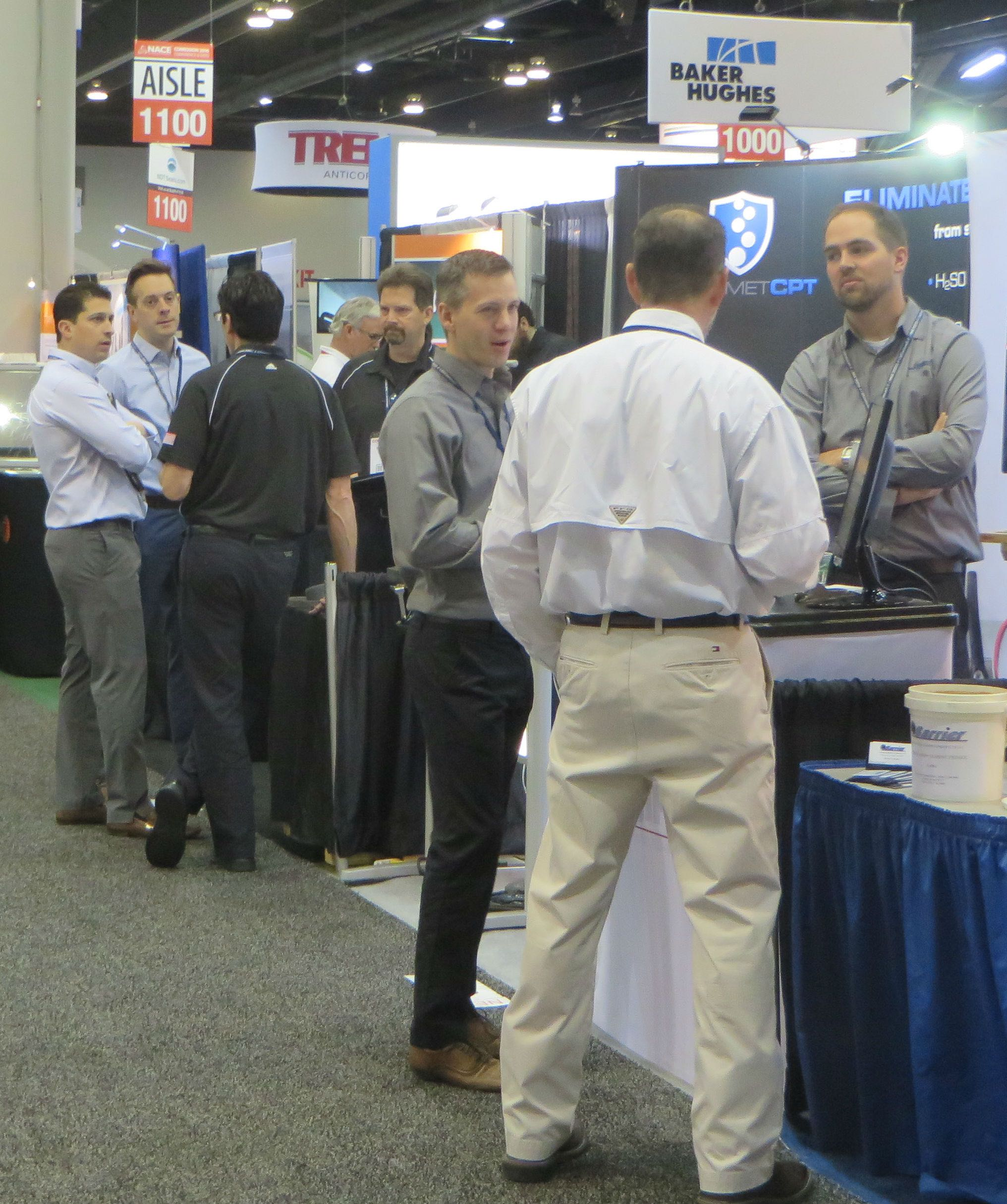 Attendees gather around one of about 350 exhibits on display at NACE Corrosion 2016.
