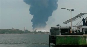 In this video grab a large plume of smoke rises from the Mexican State oil company Petroleos Mexicanos' petrochemical plant after an explosion in Coatzacoalcos, Mexico, Wednesday, April 20, 2016. The explosion killed several people, injuring dozens and sending flames and a toxin-filled cloud into the air, officials said. (Inmel Enoc via AP)