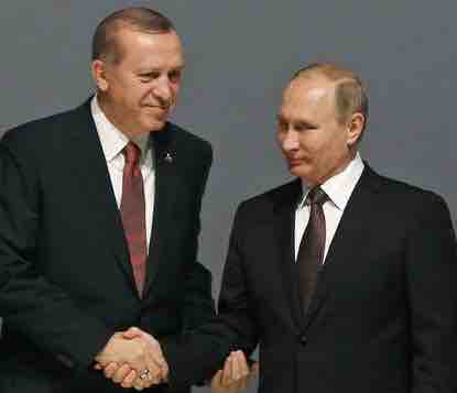Turkey's President Recep Tayyip Erdogan, left, and Russian President Vladimir Putin, right, shake hands following the group photo at the World Energy Congress. AP photo