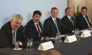 Deputy head of European Commision in charge of energy, Maros Sefcovic, right, and the presidents of Central European Visegrad Group: Poland's Andrzej Duda, center, Slovakia's Andrej Kiska, second right, the Czech Republic's Milos Zeman, left, and Hungary's Janos Ader, second left, address a news conference following a meeting on Europe's energy security that closed their two-day summit, in Rzeszow, Poland, Oct. 15.  (AP Photo/Czarek Sokolowski)