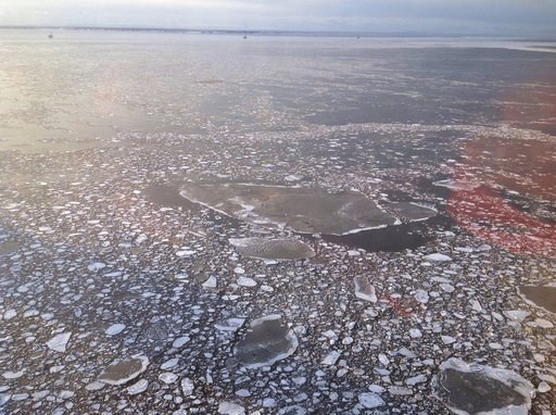 File - This April 3, 2017 photo provided by Cook Inlet Spill Prevention and Response, Inc. shows pan ice taken during an agency overflight near a Hilcorp Alaska LLC offshore platform in Cook Inlet, Alaska. Alaska's Cook Inlet is home to endangered beluga whales, a significant slice of the state's wild salmon population, and along the sea floor, a spider web of petroleum pipelines. So when natural gas was found spewing from an underwater pipeline belonging to the area's largest petroleum producer, alarm bells went off. (Derek Samora/CISPRI via AP, File)