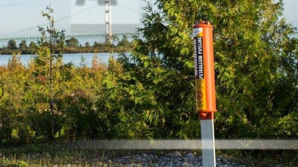 FILE- In this Sept. 23, 2015, file photo, the Mackinac Bridge is visible from a marker near Enbridge Line 5 on the northern shore of the Straits of Mackinac in Michigan. (AP photo)