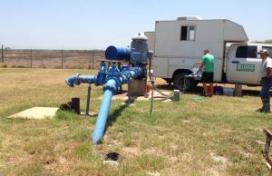 USGS scientists collecting water quality samples at a public-supply well overlying the Eagle Ford Shale production area in Texas. (Credit: Patty Ging, U.S. Geological Survey.)