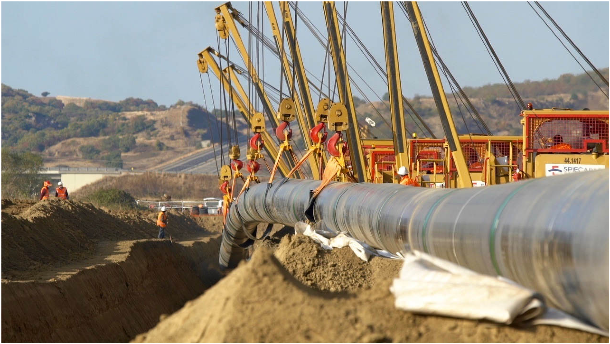 Welded steel pipes are lowered into trenches in northern Greece during November construction efforts. (Photo courtesy of Trans Adriatic Pipeline)