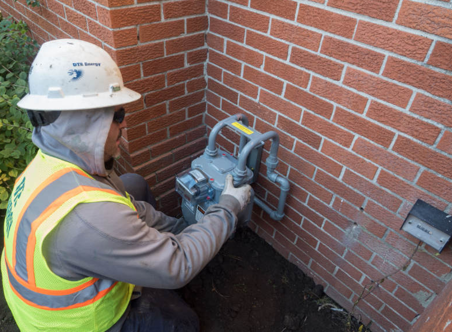 One of thousands of meter upgrades being installed outside homes.