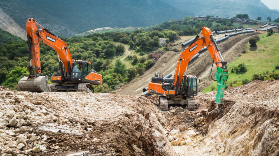 Trenching with a hydraulic breaker and earthmoving in the difficult terrain of the Kavala area.