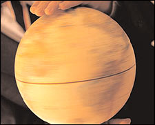 hand above spinning globe
