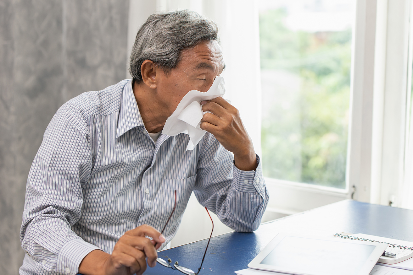 Asian Old man elder get sick from flu and runny nose when season