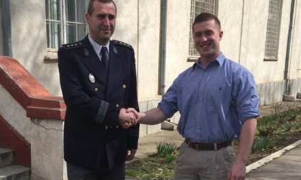 Civil affairs Soldier and Phi Tau aid Romanians in Car Accident