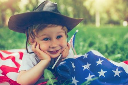 Small Boy in Cowboy Hat and American Flag
