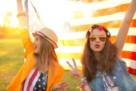 Hipster Teenage Girls In Front Of American Flag