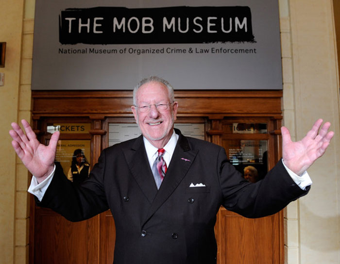 Oscar Goodman standing in front of The Mob Museum