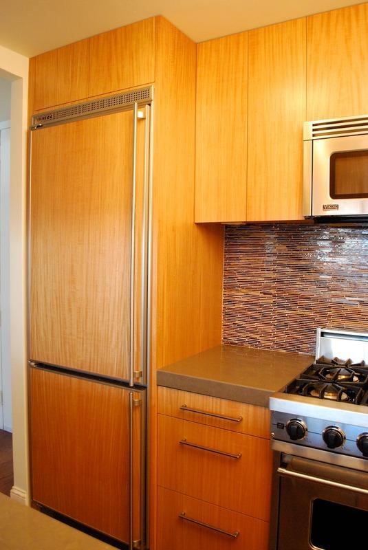 Modern kitchen in anigre upper west side sweeten for Anigre kitchen cabinets