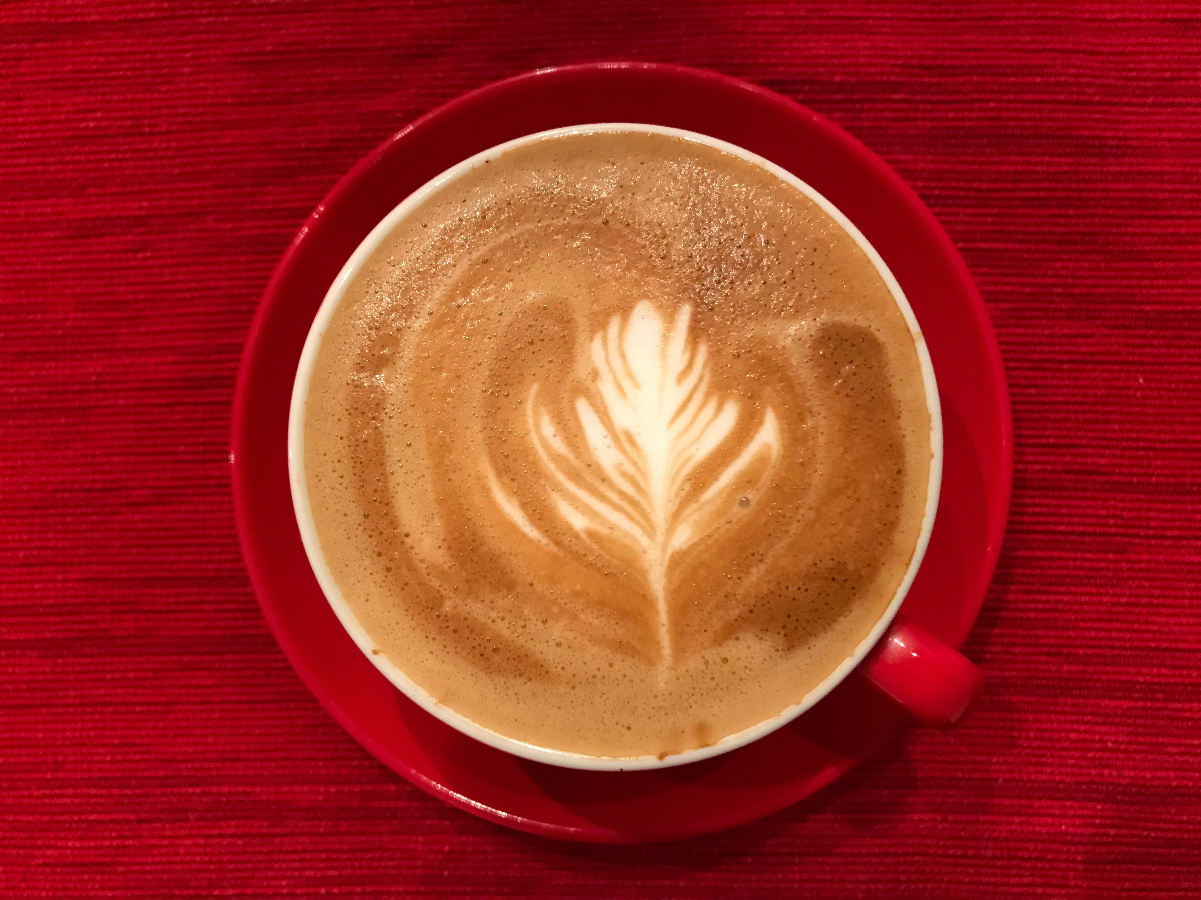 latte art on red background