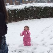 Little one throwing snow