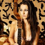 Girl with lute and mirror